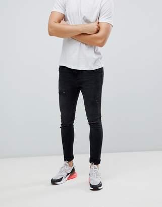 Bershka Super Skinny Jeans With Knee Rips In Black