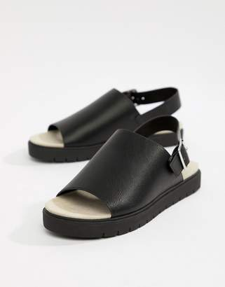 Monki slip on ankle strap sandal in black