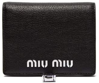 Miu Miu Logo Debossed Grained Leather Bi Fold Wallet - Womens - Black