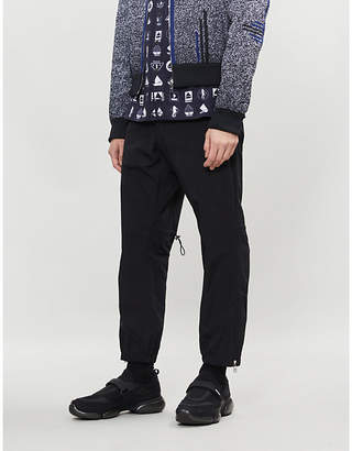 Prada Cropped relaxed-fit tapered shell trousers