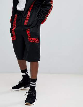 Star Wars ASOS DESIGN ASOS x Oversized Poly Tricot Shorts With Printed Tape