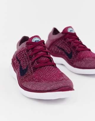 38b5f120dbd Nike Running Free Run Flyknit Sneakers In berry