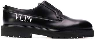 Valentino logo print derby shoes
