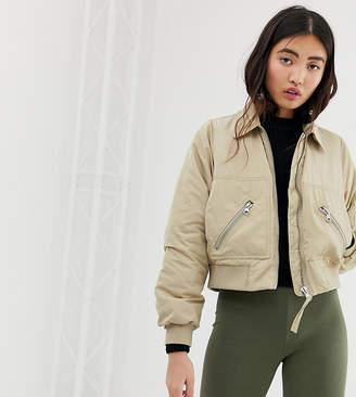 Monki short bomber jacket with oversized pockets in beige