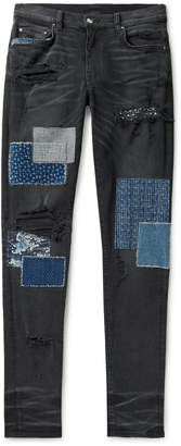 Amiri Skinny-Fit Panelled Distressed Stretch-Denim Jeans - Men - Black