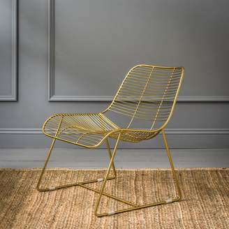 Graham and Green Maurizio Linear Lounger In Gold