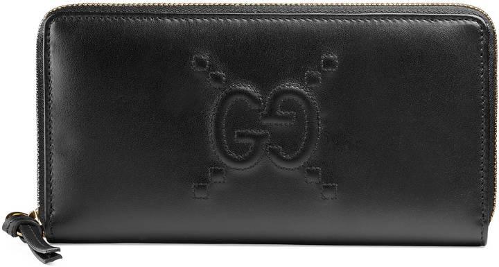 GucciEmbossed GG zip around wallet