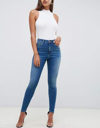Asos Design DESIGN Ridley high waist skinny jeans in mottled rich stonewash blue