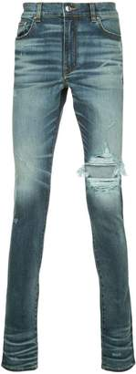 Amiri distressed denim trousers