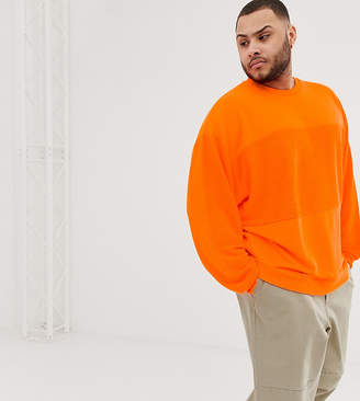 Asos Design DESIGN Plus oversized sweatshirt with reverse panel in neon orange