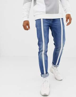 Asos Design DESIGN skinny jeans in vintage mid wash blue with front stripe