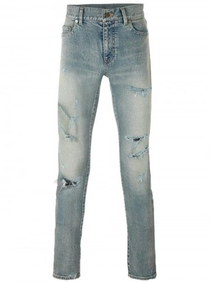 Saint Laurent distressed skinny jeans $890 thestylecure.com