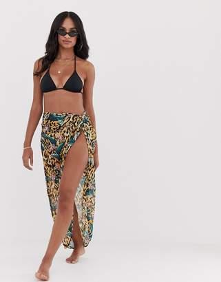 dce938e5cc Asos Design DESIGN knot front glam beach sarong in tropical animal print