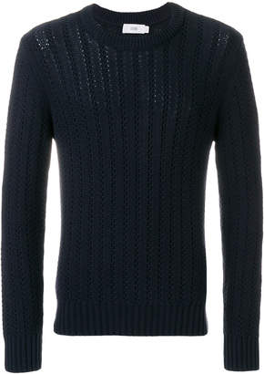 Closed crew neck open knit sweater