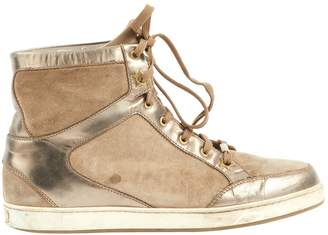 Jimmy Choo Gold Suede Trainers