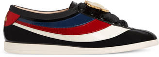 Falacer patent leather sneaker with Web $980 thestylecure.com