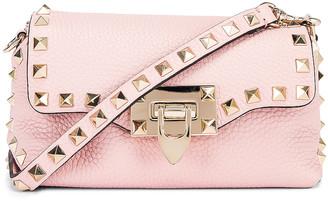 Valentino Rockstud Crossbody Bag in Water Rose | FWRD