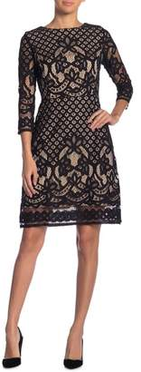 Gabby Skye 3\u002F4 Sleeve Lace Sheath Dress