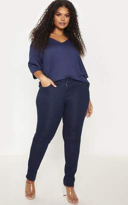 PrettyLittleThing Plus Mid Wash Pocket Detail Skinny Jeans