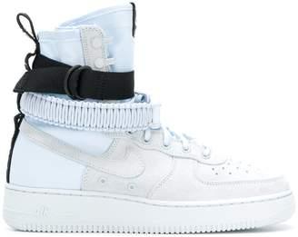 Nike side buckle sneakers