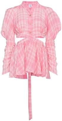 Rosie Assoulin Cutout shirt with wrap detail and peplum