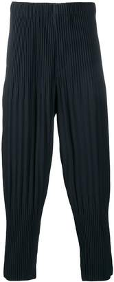 Issey Miyake Homme Plissé pleated tapered trousers