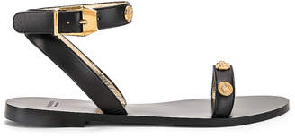 Versace Logo Sandals in Black | FWRD