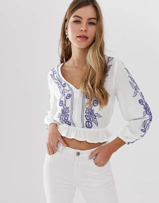 Parisian cropped wrap front embroidered blouse with peplum hem
