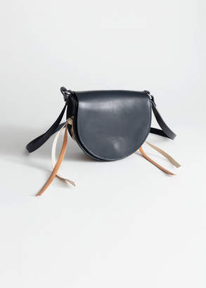 And other stories Structured Laced Leather Saddle Bag
