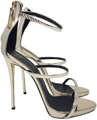 Giuseppe Zanotti Gold Patent leather Heels