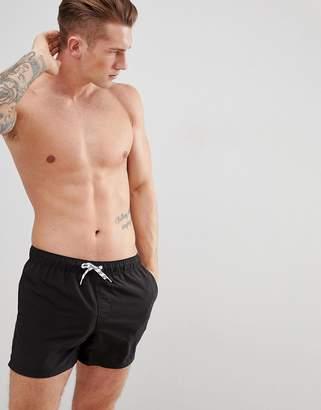 Asos Design DESIGN swim shorts in black short length
