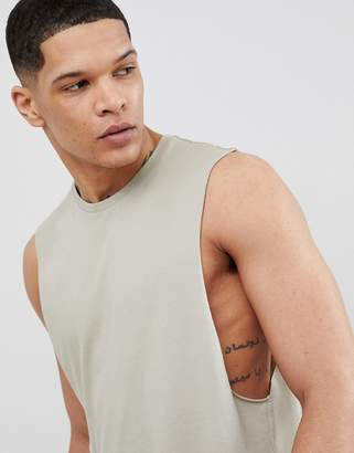 Asos DESIGN tank with dropped arm hole in green