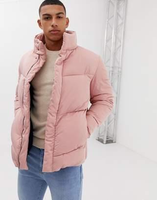 Asos DESIGN oversized puffer jacket in pink