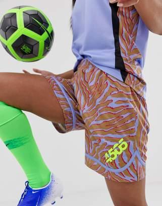 Asos 4505 4505 football short with dolphin hem in animal print