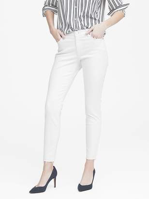 Banana Republic Petite Mid-Rise Skinny Ankle Jean with Raw Hem