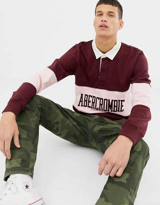 Abercrombie & Fitch logo chest panel long sleeve rugby polo in burgundy