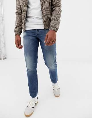 Asos Design DESIGN 12.5oz slim jeans in vintage mid wash with abrasions