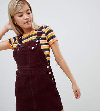 Asos DESIGN Petite cord overall dress in oxblood
