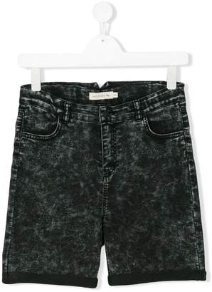Andorine Acid Fade denim shorts