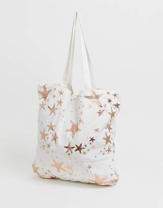 a69830b74ce99e Asos Design DESIGN large cotton beach tote bag in rose gold starfish print