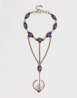 Design DESIGN hand harness in burnished gold with semi-precious stones