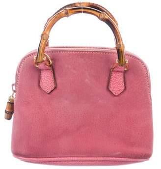 71563fbba3a672 Gucci Vintage Mini Bamboo Bag