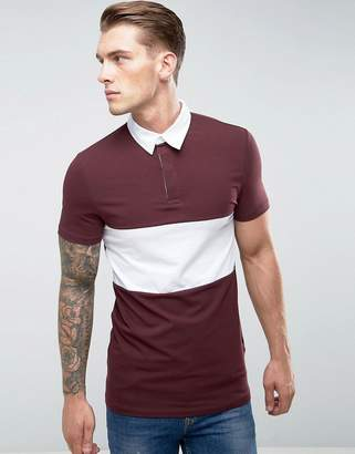 Asos DESIGN Longline muscle fit Rugby Polo Shirt In Oxblood With Contrast Panel