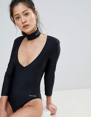 Calvin Klein Long Sleeved One Piece Swimsuit