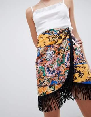 Asos DESIGN scarf print wrap mini skirt with fringe hem