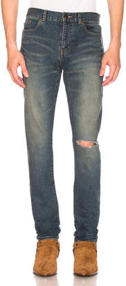 Saint Laurent Low Rise Destroyed Skinny Jeans