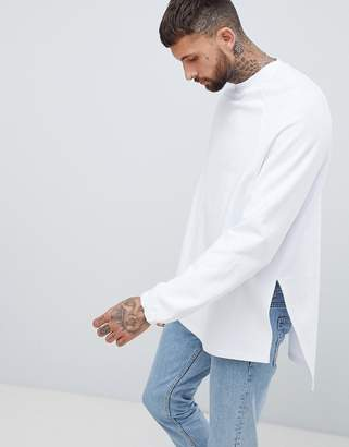 Asos DESIGN super longline oversized sweatshirt with side splits and dropped hem in white