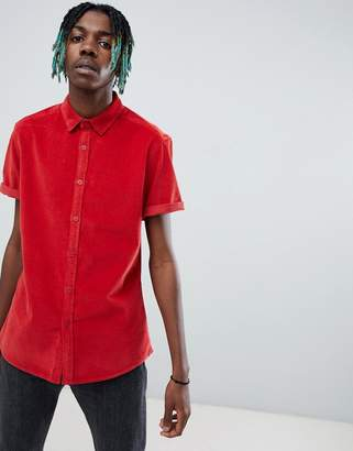 Asos DESIGN slim fit stretch cord shirt in red