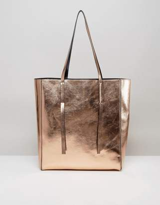 ASOS Metallic Unlined Tab Detail Shopper Bag $32 thestylecure.com