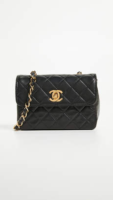 Chanel What Goes Around Comes Around Lambskin Half Flap Micro Bag